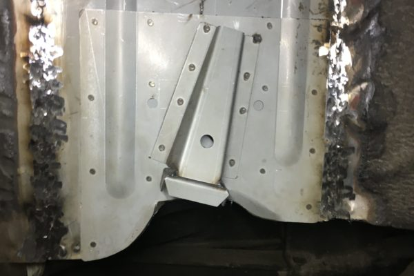 Fitting and welding the suspension stop repair panels